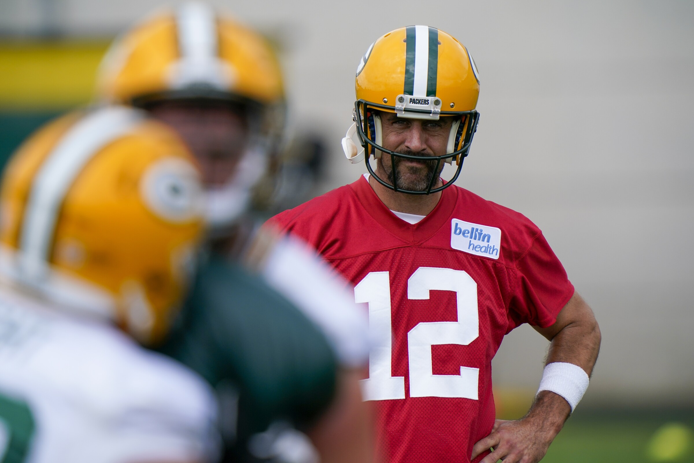 Green Bay Packers' Aaron Rodgers watches during NFL football training camp Saturday, Aug. 15, 2020.
