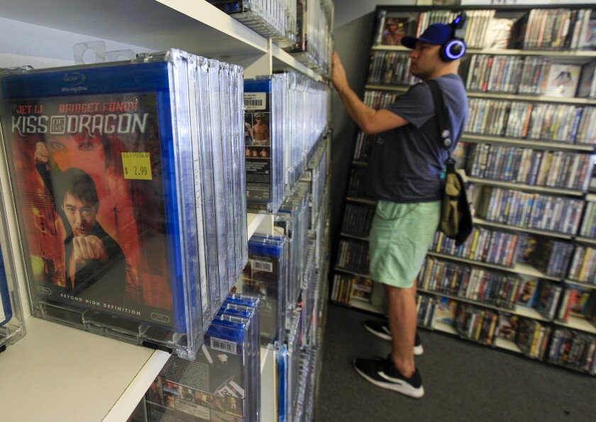 A customer browses the selections at Video Paradiso in Claremont Village.