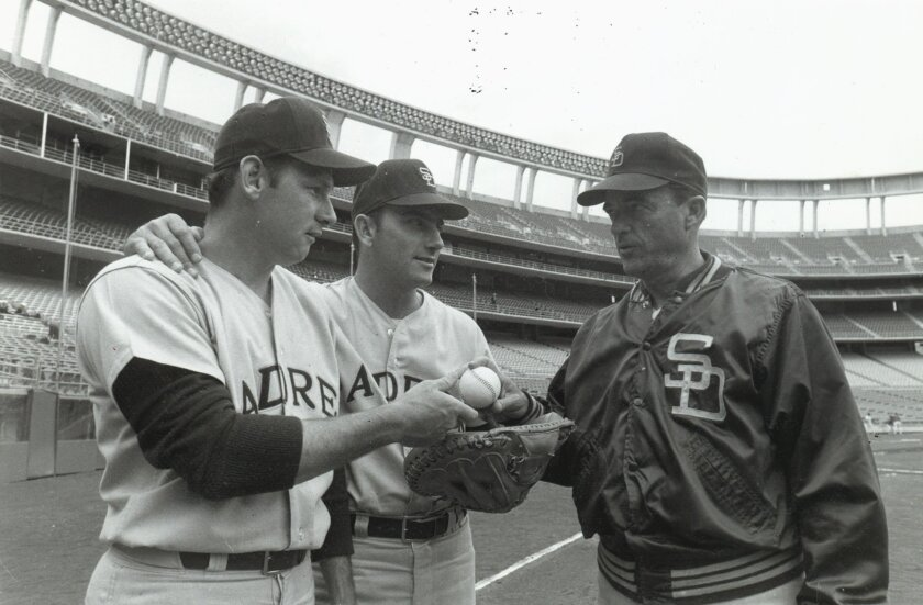 Opening Day Padres pitcher Dick Selma (left) and catcher Chris Cannizzaro talk with manager Preston Gomez at San Diego Stadium, where the major league Padres later played their first game.