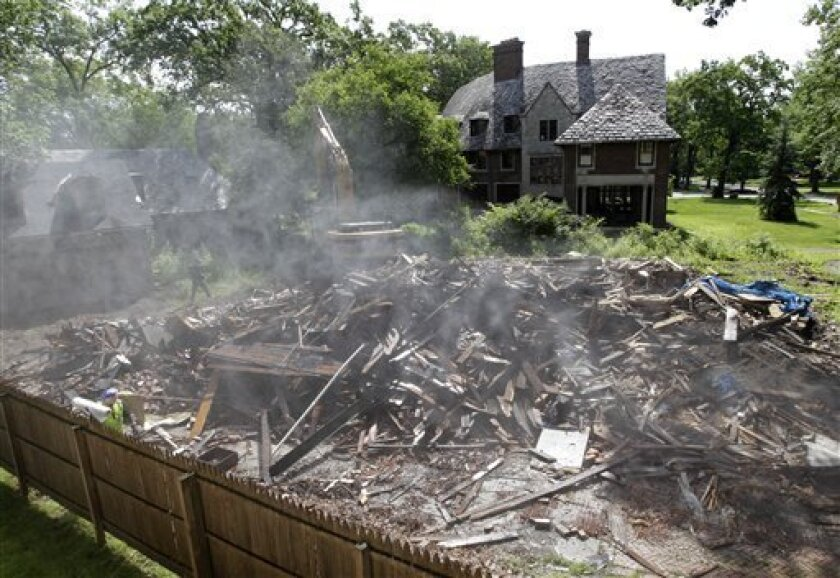 The former home of one of Michigan's most prominent political families lies in debris after being demolished in Detroit Tuesday, June 8, 2010. Crews on Tuesday are demolishing, as part of Detroit's plan to tear down neighborhood eyesores and dangerous houses, the 5,500-square-foot, two-story structure where George Romney raised his family for a time before being elected governor. Former Massachusetts governor and one-time Republican presidential candidate Mitt Romney was raised in the home in the once prestigious Palmer Woods area. (AP Photo/Paul Sancya)