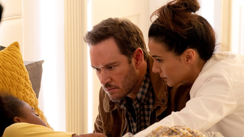 "Saniyya Sidneyl, left, Mark-Paul Gosselaar and Emmanuelle Chriqui in ""The Passage"" on Fox."