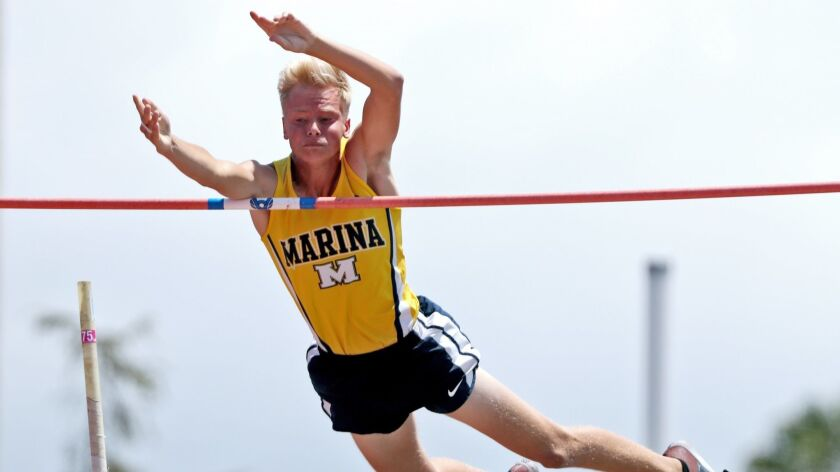 """Marina High school athlete Skyler Magula clears 15'9"""", a personal record, in the boys pole vault eve"""