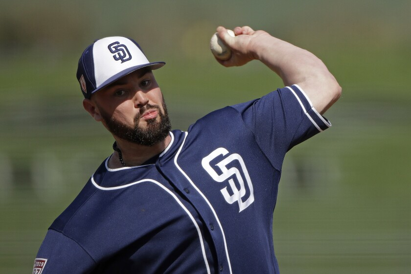 San Diego Padres pitcher Logan Allen throws during the fourth inning of a spring training baseball g