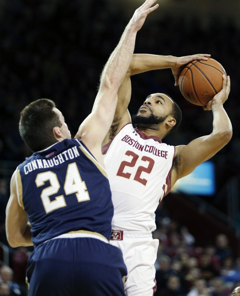 Boston College's Aaron Brown (22) shoots over Notre Dame's Pat Connaughton (24) during the first half of an NCAA college basketball game in Boston, Saturday, Feb. 21, 2015. (AP Photo/Michael Dwyer)