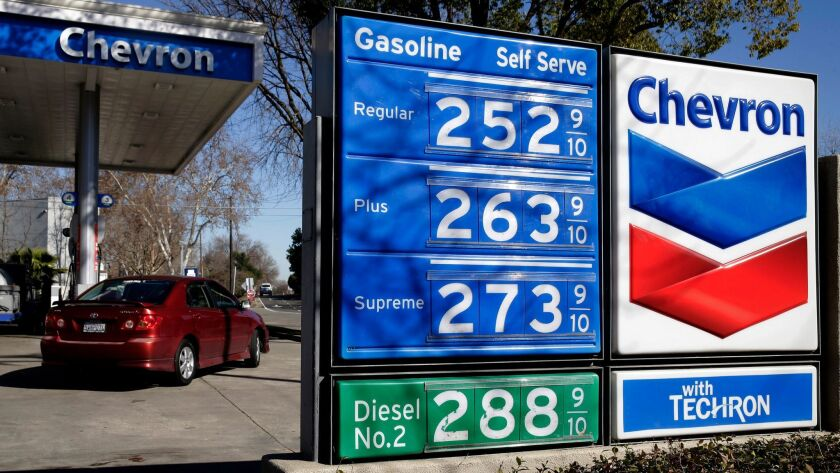 FILE - In this Monday, Feb. 8, 2016, file photo, gas prices are displayed at a Chevron gas station i