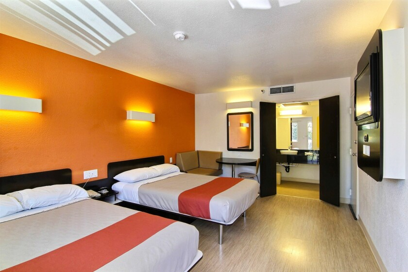 Motel 6's renovated double rooms feature beds with a pillow top mattress, carpet-free floors and accents in bright colors.