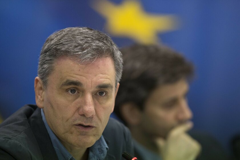 Greek Finance Minister Euclid Tsakalotos, speaks during a news conference about Greece's bailout program, in Athens, Thursday, May 26, 2016. Bailout-dependent Greece has agreed to carry out new austerity measures and reforms to secure vital rescue loans from its European creditors. (AP Photo/Petros