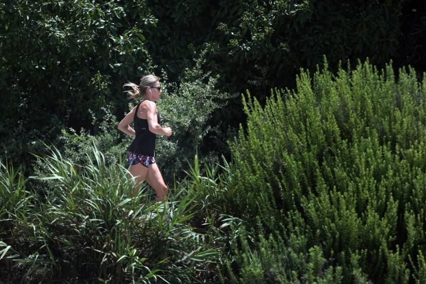 A runner jogs at Salt Creek Beach Park in Dana Point on Tuesday.