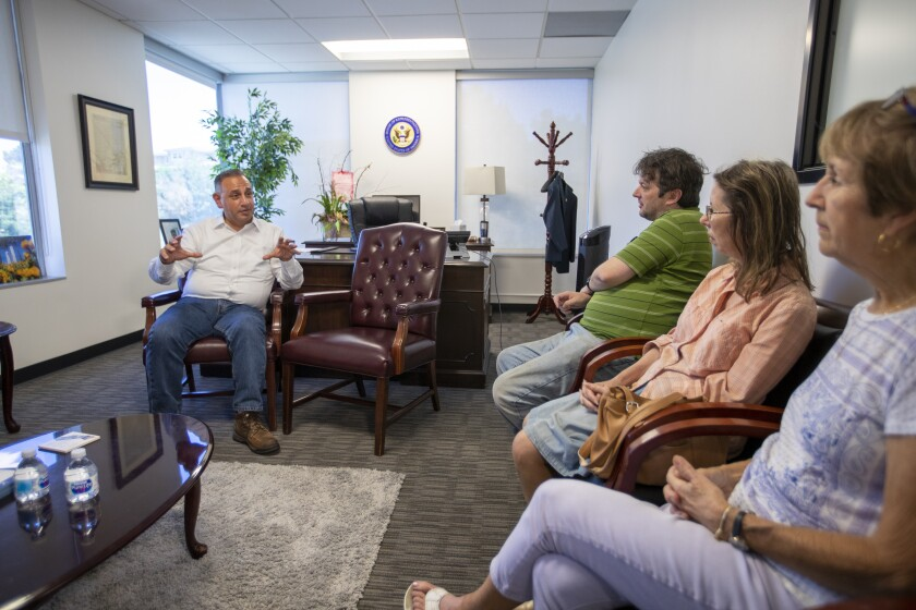 Rep. Gil Cisneros speaks with constituents