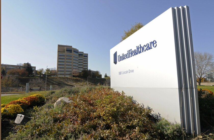 FILE - This Tuesday, Oct. 16, 2012, file photo, shows a portion of The UnitedHealth Group Inc.'s campus in Minnetonka, Minn. UnitedHealth announced Thursday, Nov. 19, 2015, it is chopping its 2015 earnings forecast, citing hits it expects to take from new public insurance exchanges. (AP Photo/Jim Mone, File)