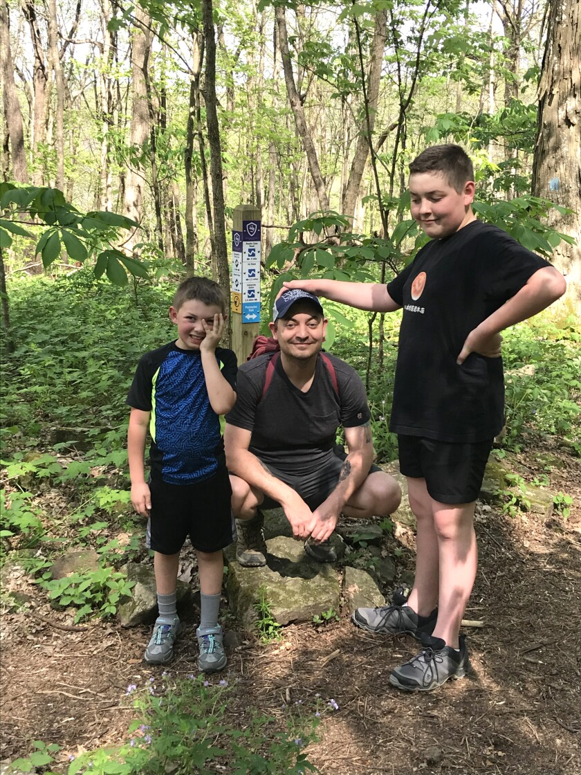 """Author Kevin Wilson, flanked by younger son Patch, left, and older son Griff, is the author of """"Nothing to See Here"""" and """"The Family Fang."""""""