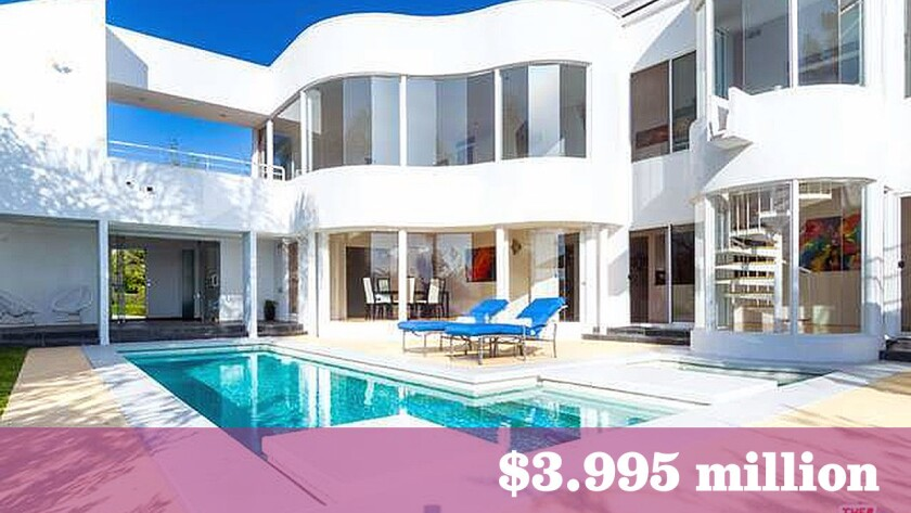 Film producer Anton Lessine has paid $3.995 million for a modern-style home in Pacific Palisades.