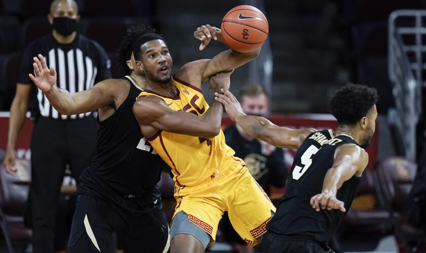 USC's Evan Mobley is fouled by Colorado's D'Shawn Schwartz during the first half of Thursday's game.