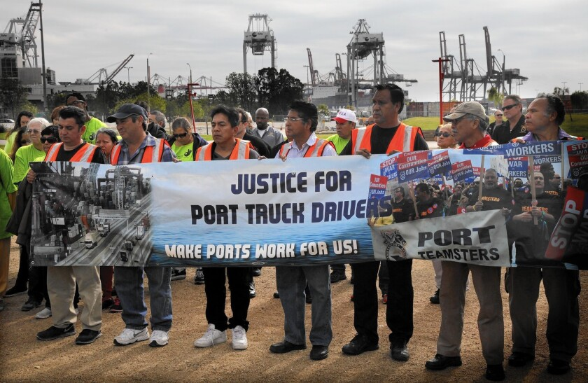 Port truckers drive home difference between contractors and