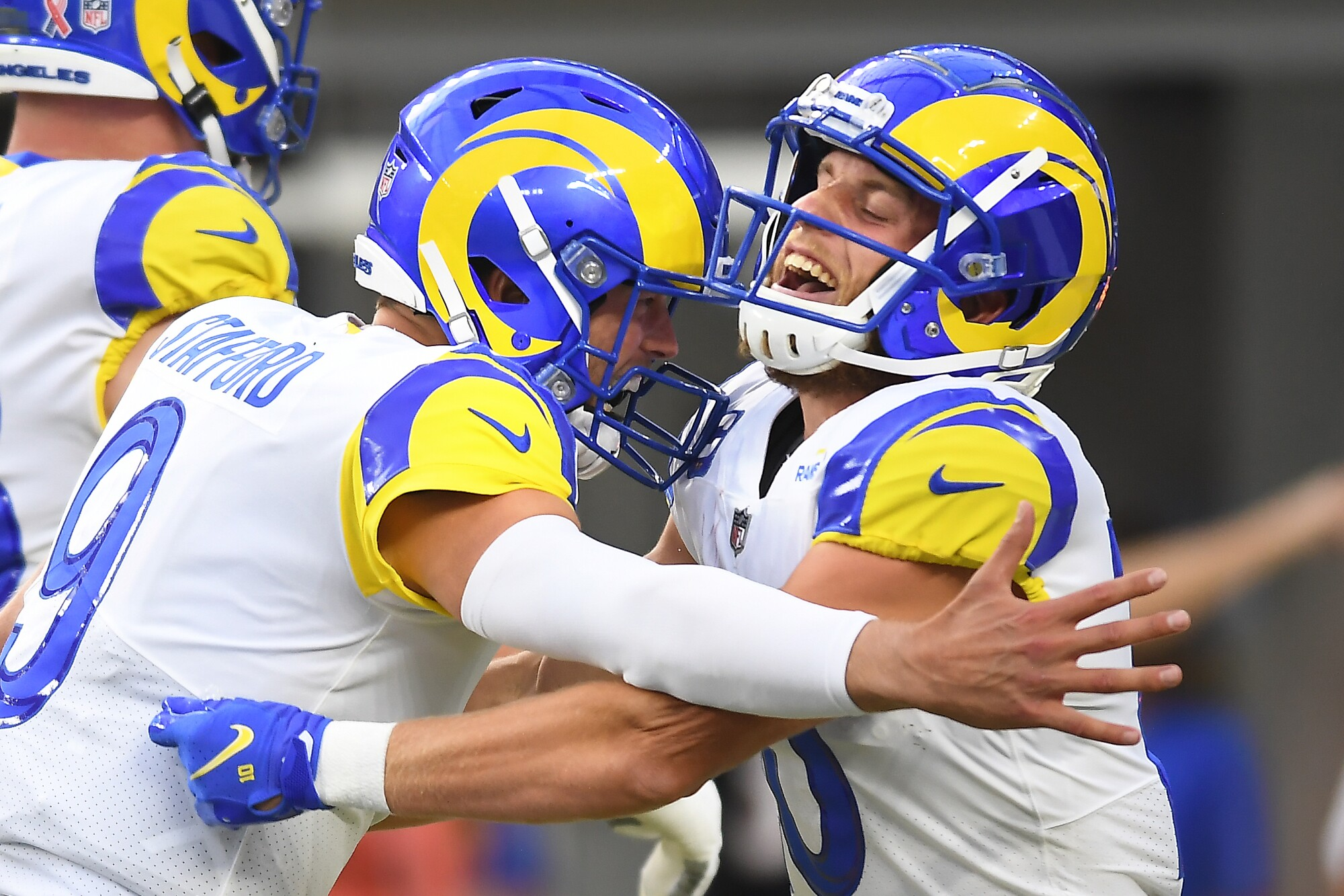 Rams quarterback Matthew Stafford, left, celebrates his touchdown pass with wide receiver Cooper Kupp.
