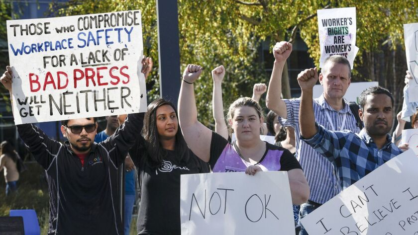 Google workers in Mountain View, Calif., hold signs during a walkout to protest workplace policies on Nov. 1.