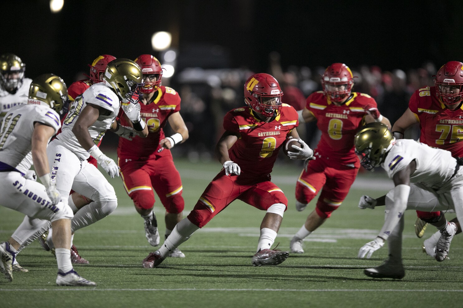 Dons' rally in fourth quarter buries rival Saints