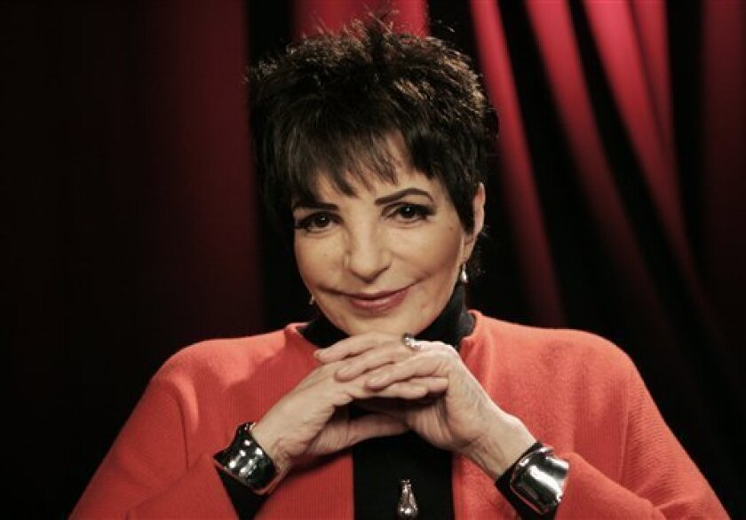 FILE - In this Nov. 19, 2009 file photo, performer Liza Minnelli poses for a portrait in New York. (AP Photo/Jeff Christensen)