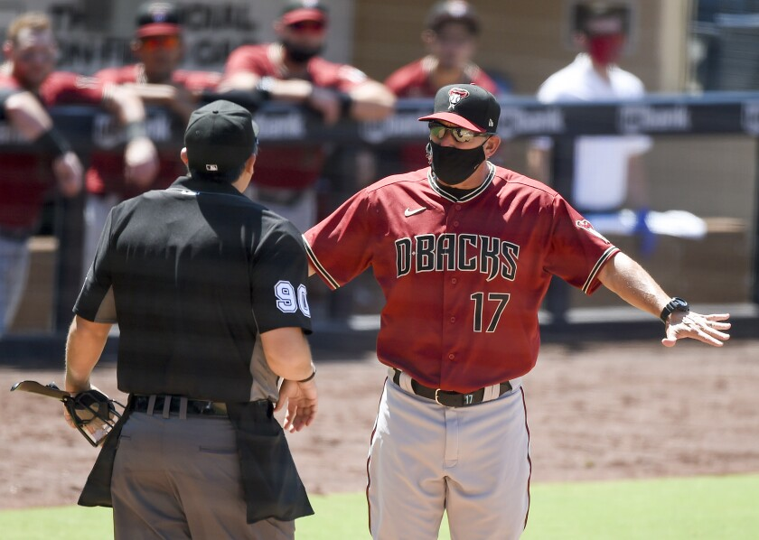 Arizona manager Torey Lovullo argues a call with home plate umpire Mark Ripperger during the fifth inning of Sunday's game.