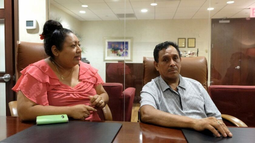 Francisco Morales, an undocumented immigrant erroneously picked up on sexual assault charges and detained at Rikers, talks to the Daily News next to his live-in partner Rosa Jimenez, Wednesday.