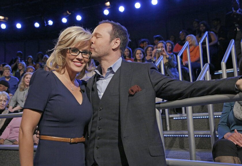 "FILE - In this April 16, 2014, file photo released by ABC shows co-host Jenny McCarthy with her fiance Donnie Wahlberg after she announced her engagement on the daytime series ""The View,"" in New York. Wahlberg's ""Favorite Girl"" McCarthy is now his wife. The couple tied the knot Sunday, Aug. 31, 2014, in a ceremony outside Chicago, McCarthy's publicist, Brad Cafarelli, confirmed. (AP Photo/ABC, Heidi Gutman, File)"