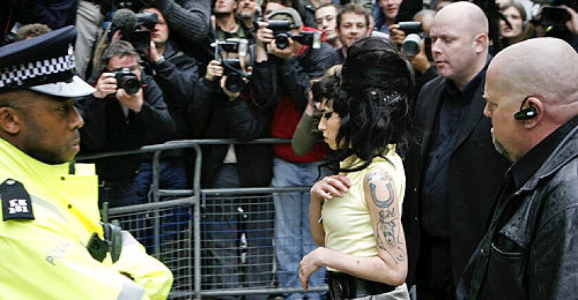 Amy Winehouse didn't say anything to assembled photographers and cameramen as she walked into the Holborn Police Station late Friday afternoon.