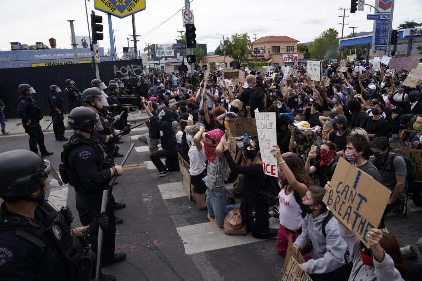People protest at Pan Pacific Park in Los Angeles.