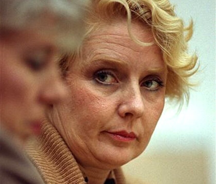 This Nov. 13, 1991, photo shows Betty Broderick looking across the courtroom during her trial for murder at the San Diego County Courthouse. She was convicted of murdering her ex-husband and his new wife.