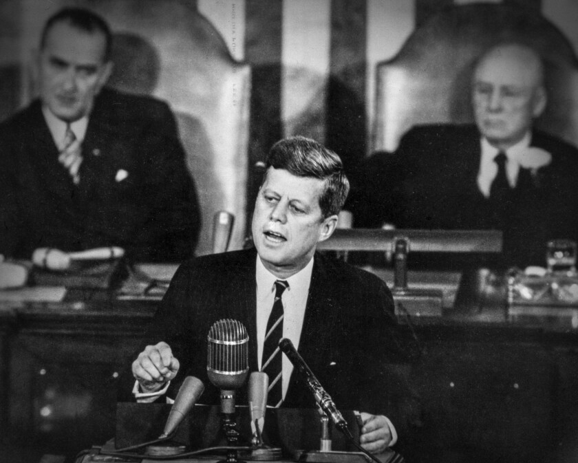 In May 1961, President Kennedy addresses Congress and announces his goal of sending an American to the moon before the end of the decade.