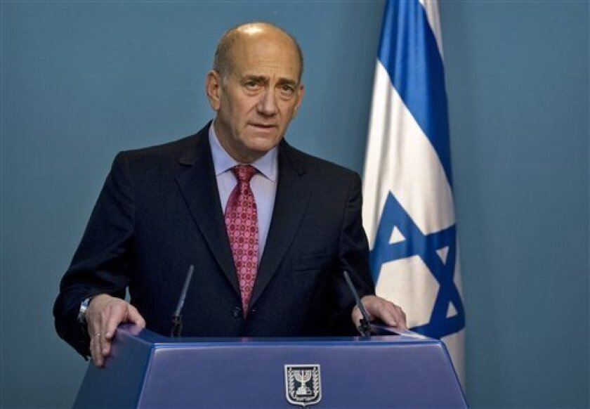 FILE- In this March 17, 2009 file photo, then Israeli Prime Minister Ehud Olmert gives a statement to the media at his Jerusalem office. Former Israeli Prime Minister Ehud Olmert has been indicted Thursday, Jan. 5, 2012, on new corruption charges. (AP Photo/Sebastian Scheiner, File)
