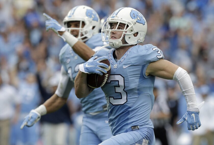 North Carolina's Ryan Switzer (3) runs for a touchdown against Duke as Mack Hollins reacts in the background during the first half of an NCAA college football game in Chapel Hill, N.C., Saturday, Nov. 7, 2015. (AP Photo/Gerry Broome)