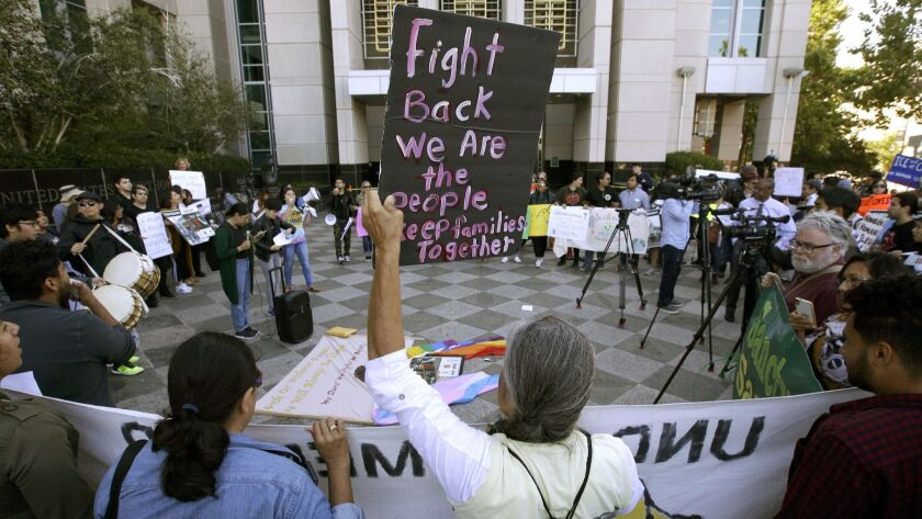 Protesters demonstrate in 2018 outside the federal courthouse in Sacramento, where a judge heard arguments over the Trump administration's bid to block three California immigrant-sanctuary laws. A federal appeals panel heard arguments in the case Wednesday.