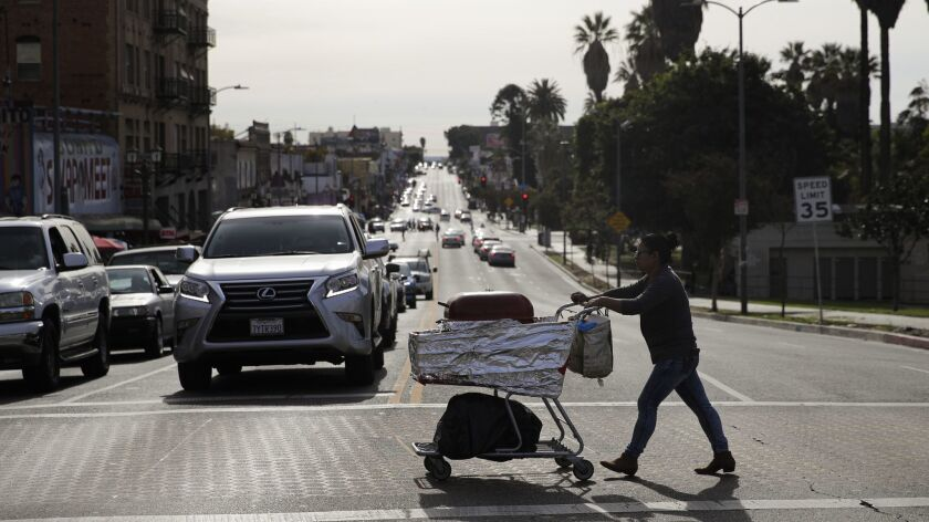 A food vendor pushes her cart Tuesday, Nov. 27, 2018, in Los Angeles. The Los Angeles City Council h