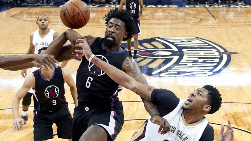 Clippers center DeAndre Jordan (6) and Pelicans forward Anthony Davis (23) battle for a rebound during the first half Thursday in New Orleans.