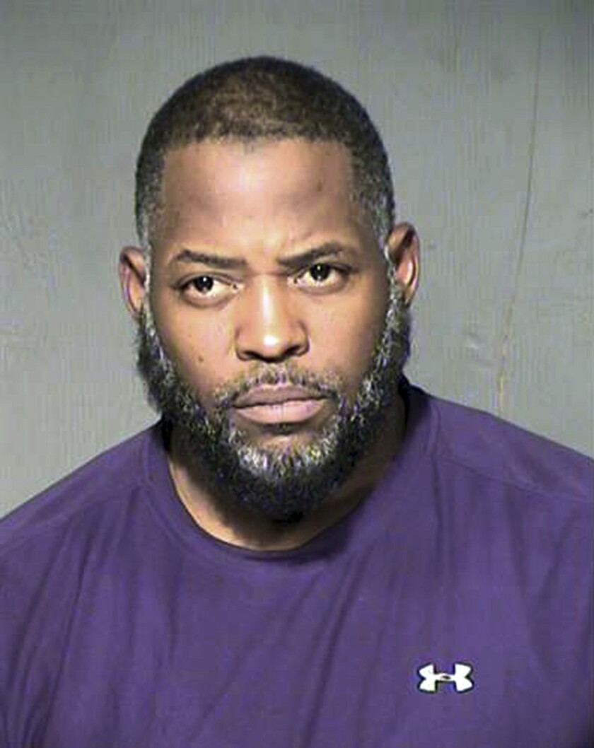 This undated file photo provided by the Maricopa County Sheriff's Department shows Abdul Malik Abdul Kareem.
