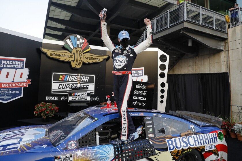 Race driver Kevin Harvick celebrates after winning the NASCAR Cup Series auto race at Indianapolis Motor Speedway in Indianapolis, Sunday, July 5, 2020. (AP Photo/Darron Cummings)