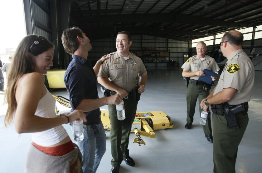 At a press conference on Aug. 26, 2010, rock climbers Meg Rippy and Andre Doria, left,  both 27, were brought together with sheriff's deputies Scott Bligh, center, and Gary Kneeshaw, far right,  who rescued them. At center right, in background, is Lt. Todd Richardson.