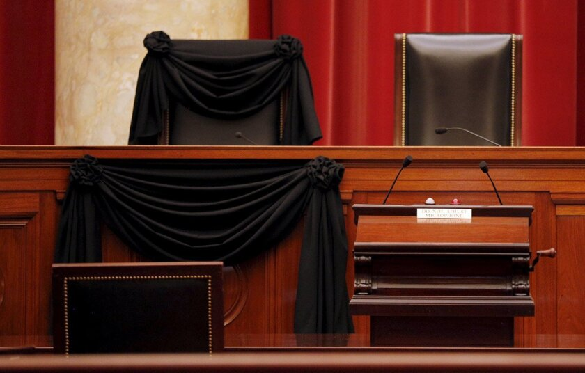 The bench of late Supreme Court Justice Antonin Scalia is seen draped with black wool crepe in memoriam inside the Supreme Court in Washington, D.C.