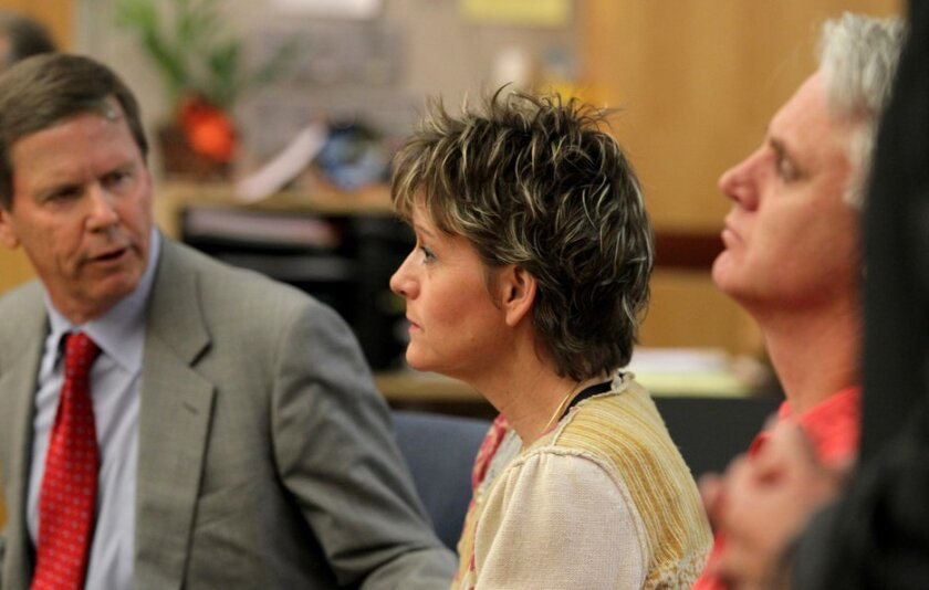 Scott Eveland's mother Diane Luth and her husband Paul Luth with attorney David Casey Jr. (left)