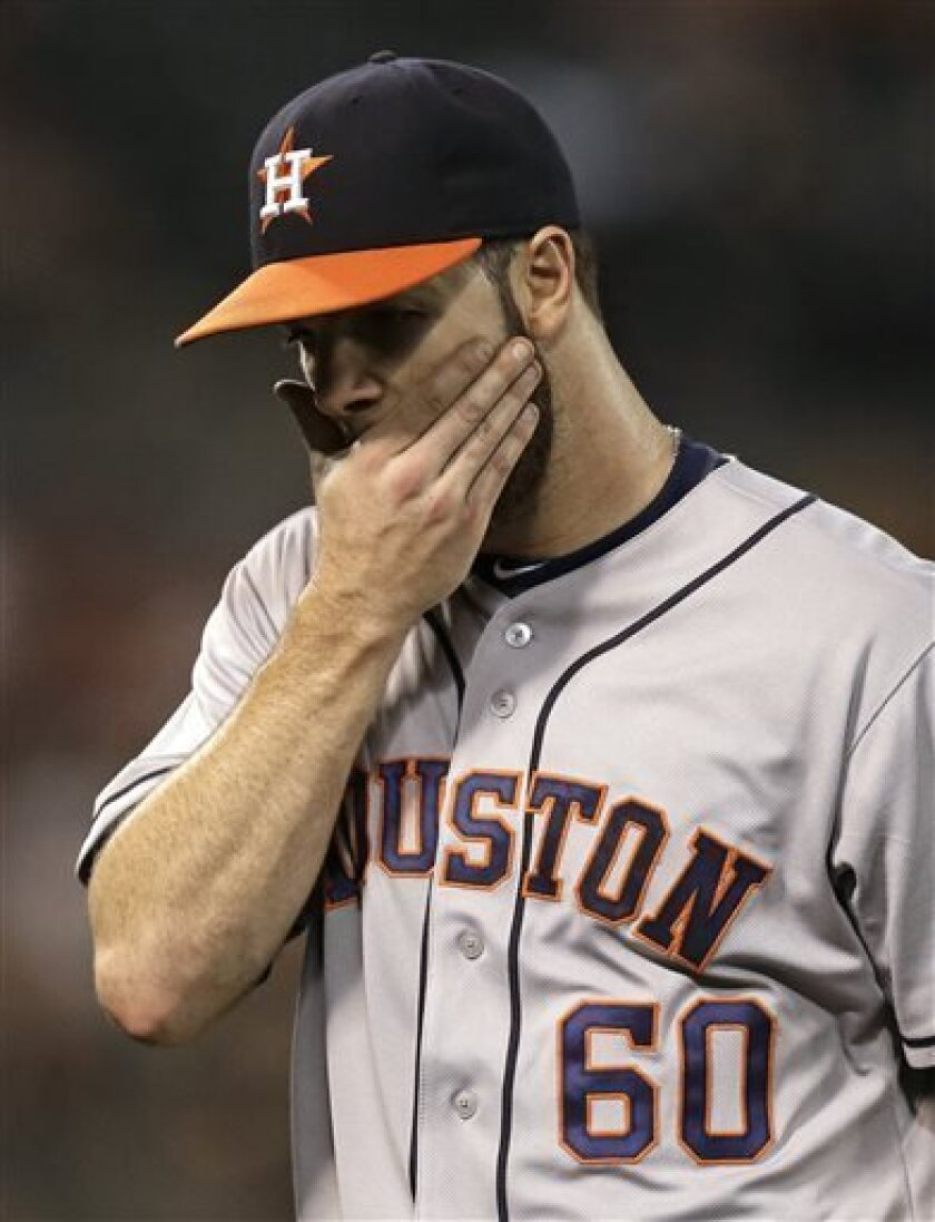 Houston Astros' Dallas Keuchel wipes his face after being removed from the baseball game against the Oakland Athletics in the fourth inning Friday, Sept. 6, 2013, in Oakland, Calif. (AP Photo/Ben Margot)