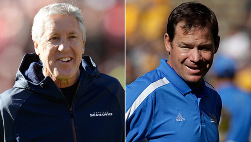 Seattle Seahawks Coach Pete Carroll, left, says college coaches feel more responsible for what their players do on and off the field than NFL coaches. UCLA Coach Jim Mora understands the larger set of responsibilities college coaches have over their NFL counterparts, but he still prefers coaching at the college level.