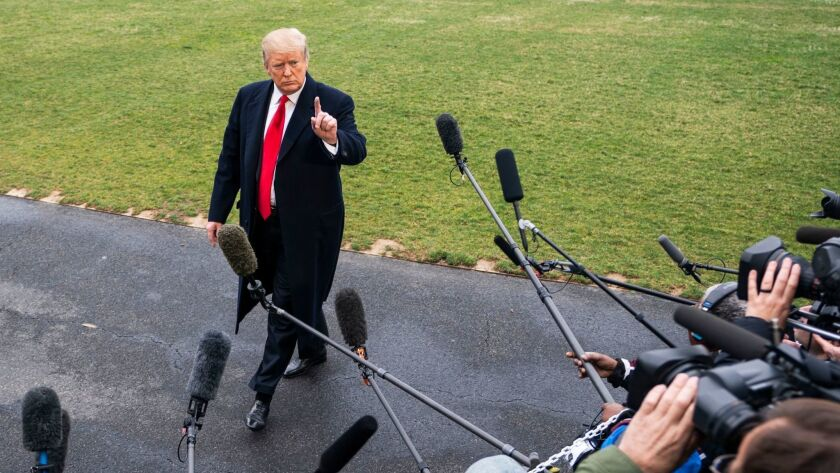 President Trump speaks to the media as he departs the White House for his Mar-a-Lago resort in Florida on March 22.