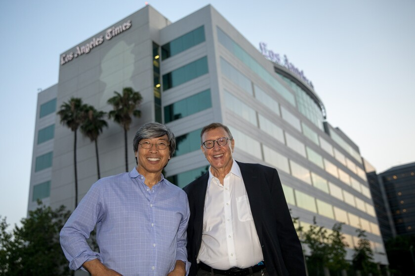 Dr. Patrick Soon-Shiong and Norman Pearlstine stand outside the L.A. Times building in El Segundo in July 2018.
