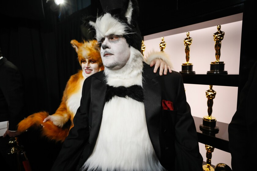 "James Corden and Rebel Wilson prepare to go onstage in a self-deprecating ""Cats"" bit."