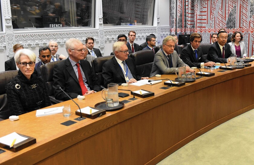 Negotiators Wendy Sherman, left, of the U.S., Simon Gass of Britain, Sergei Ryabkov of Russia, Hans-Dieter Lucas of Germany, Nicolas DeRiviere of France and Wang Min of China attend a meeting at the U.N. about Iran.