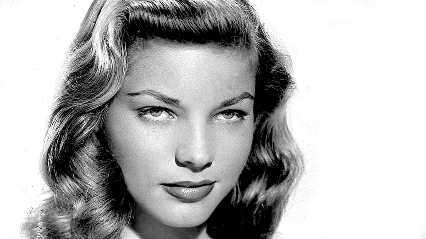 """Only 19 when she made her Hollywood debut, Bacall was known for her deep, husky voice and """"The Look,"""" a sultry look with her chin low and eyes up toward the actor or camera."""