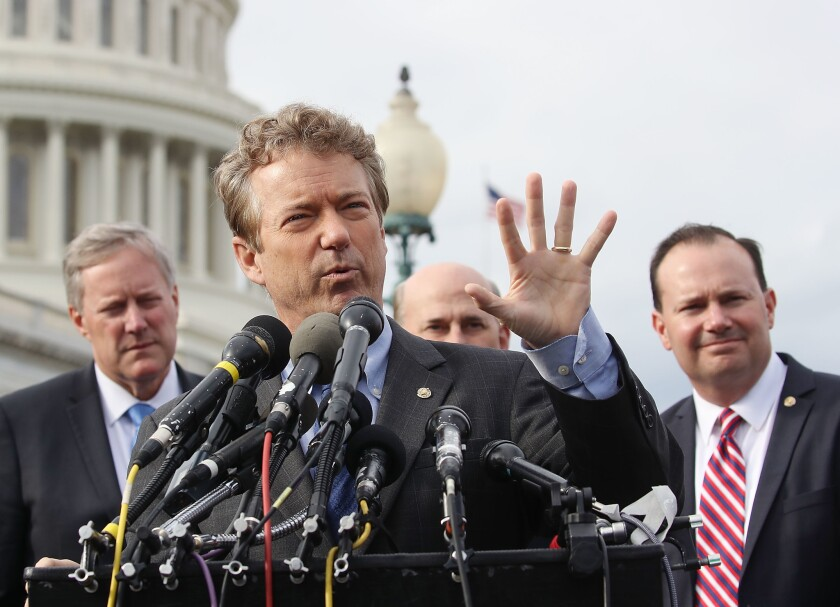 Sen. Rand Paul (R-Ky.) speaks about Obamacare repeal, flanked by Sen. Mike Lee (R-Utah), far right,