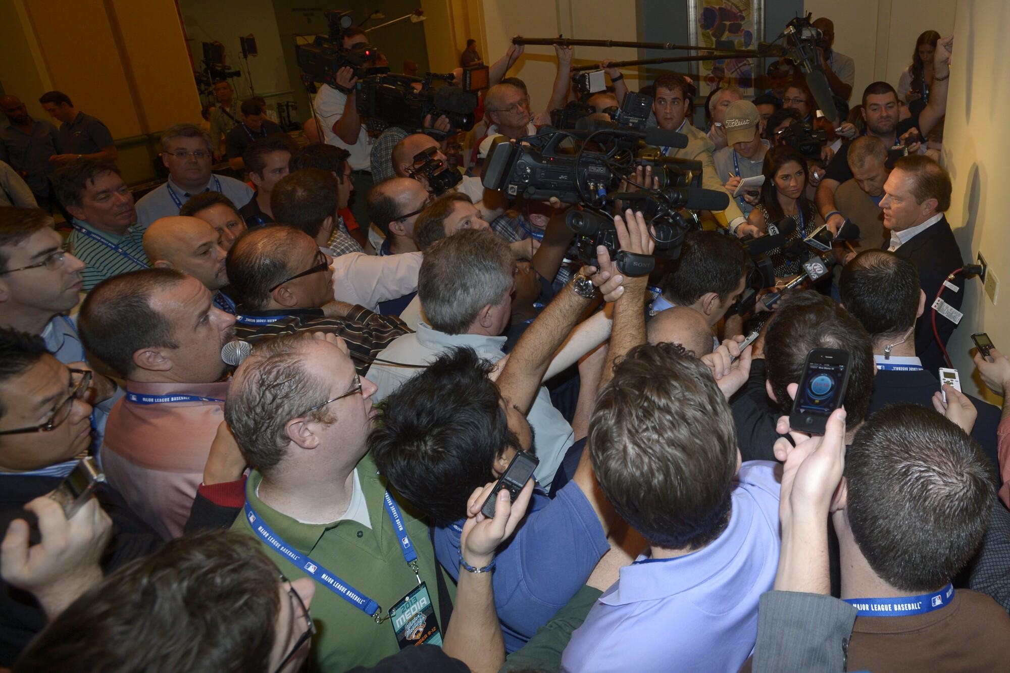 Agent Scott Boras, right, speaks to the media at baseball's winter meetings Dec. 11, 2013, in Lake Buena Vista, Fla.