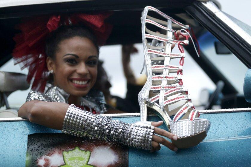 Miss New Jersey Cierra Kaler-Jones displays her shoe during the Miss America Shoe Parade at the Atlantic City boardwalk, Saturday, Sept. 13, 2014, in Atlantic City, N.J. (AP Photo/Julio Cortez)
