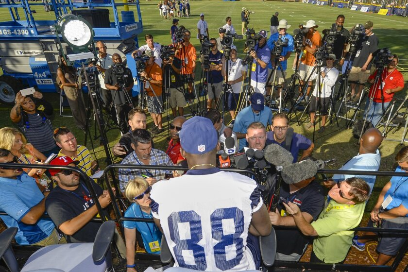 Dallas Cowboys wide receiver Dez Bryant takes questions from the media during Dallas Cowboys' NFL training camp, Thursday, July 30, 2015, in Oxnard, Calif. (AP Photo/Gus Ruelas)